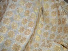 This listing is for 1 yard Chanderi Cotton Silk in Beige with Zari woven motifs all over. The fabric is slightly sheer. You can use this fabric to make dresses, tops, Crafting, Drapery, Home...