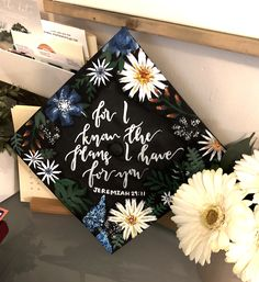 Graduation cap. Floral design. For I know the plans I have for you. Jeremiah 29:11. Hand lettered. Hand painted. DIY ideas. #graduation #graduationcap #gradcap #flowers #jeremiah2911 #bible #quote #inspiration #graduate #designs #moderncalligraphy #handlettered #painted #diy #ideas #gradcapideas #graduationcapideas