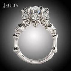 Jeulia Round Cut Created Emerald Three Skull Design Skull Ring