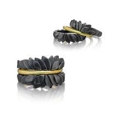 Stacking Leaf Rings by Giselle Kolb. These stacking rings are composed of two leaf-formed rings in oxidized sterling silver, set apart from one another by a thin 18k yellow gold band. Sold in a set, as shown.