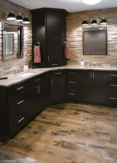 Dark colors add a masculine touch to a master bath