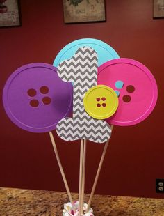 Cute as a button birthday party centerpiece by Kirascollection