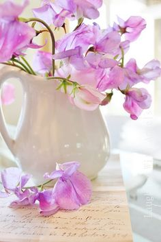 Sweet peas - love the white pitcher as a vase.  via Living Cottage