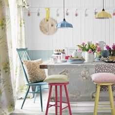 Woodland-themed dining room with brightly painted seating