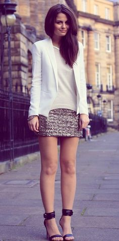 Shop this look on Lookastic:  http://lookastic.com/women/looks/heeled-sandals-mini-skirt-blazer-crew-neck-sweater-necklace/6162  — Black Leather Heeled Sandals  — Gold Sequin Mini Skirt  — White Blazer  — Beige Crew-neck Sweater  — Silver Necklace