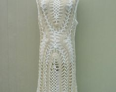 Cute hippie crochet fringe dress Perfect to creat a hippie boho chic look or as beach cover up with your favorite crochet bikini set  Measurement: Bust: 35-36 Length: 22 and 33 with tassels  Crocheted in easy care acrylic yarn, machine wash cool, gentle cycle, and short machine dry, low heat, or roll in a towel to remove excess water and lay flat to dry.  Please be sure to read my policies before purchasing. Feel free to let me know if you need a different color or size. thank you