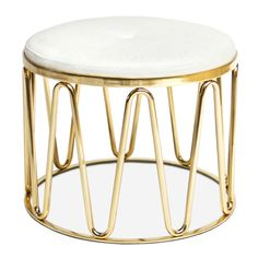 Modern Elegance.A sinuous framework of gleaming brass cradles a round seat upholstered in a Palermo Dove basketweave with a brass button. Our Maxime Tuffet