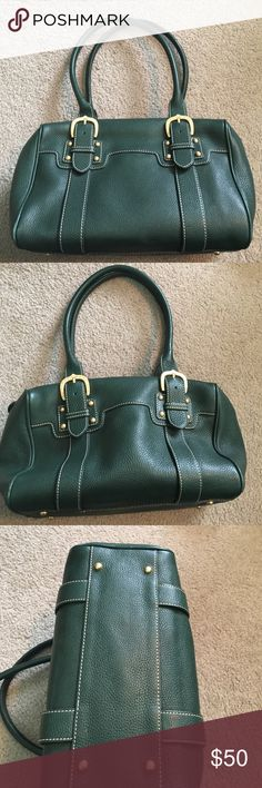 Dooney and Bourke Purse Dark green leather purse from Dooney. Exterior is almost perfect, just a few flaws can be seen in photos. Interior is perfect! Dooney & Bourke Bags