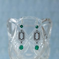 Art Deco-style earrings reminiscent of the famous leadlight windows of the 1920s. Crafted with genuine crystal bicones in emerald green.
