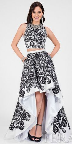 Be picture perfect at your next event in this Damask Printed High-Low Prom Dress by Terani Couture. This style includes a jewel neckline that is embellished with intricate beading. The body of this style is covered in a bold damask print that is simply breath taking. The high-low A-line silhouette skirt includes in seam pockets and has box pleats at the waist. #edressme