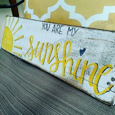 You are my Sunshine wood pallet sign! Perfect for a play room or childs nursery! You can also add a touch of sunshine to any room in your home, with this rustic wood sign. This sign is completely hand painted by me, no vinyl letters or stencils are used! Approximately 5x18 with hardware attached. This sign has a beautiful hand drawn sunshine in the left corner with hand lettered charcoal grey and yellow lettering and grey shadowing. I hand letter and paint each and every sign that ...