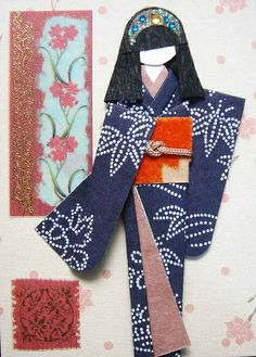 handmade card ... origami doll dressed in blue ... like the sparkly headband ...