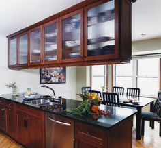 Kitchen peninsula with glass upper cabinet doors?