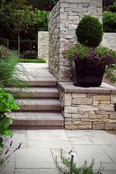 Fond du Lac Country Squire exterior stone veneer is used for the outdoor fireplace stone & landscape stone walls of this stunning space.