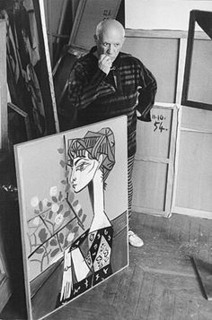 """Pablo Picasso (Spanish, 1881–1973), artist in his studio #workspace with his portrait """"Jacqueline With Flowers."""" Photo by David Douglas Duncan. #arthistory"""