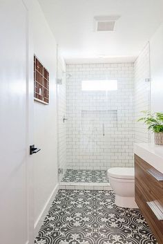 A modern bathroom makeover, with a black, white and brass colour scheme. Subway tiles with dark grout and black bathroom fixtures make the room feel thoroughly modern. #bathtubmodern #bathroomideas #bathroomdecor #whitebathroom Condo Bathroom, Modern Bathroom, Bathroom Inspo, Bathroom Designs, Bathroom Fixtures, White Subway Tile Bathroom, Black White Bathrooms, Subway Tiles, Interior Design Work