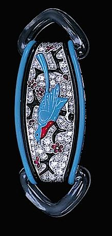 AN ENAMEL, DIAMOND, ROCK CRYSTAL AND RUBY BROOCH, BY BLACK, STARR & FROST Designed as a diamond tapered panel applied with an enamel blue bird perched on a black enamel branch with cabochon ruby flowers to the black and blue enamel striped borders and triangular rock crystal terminals, circa 1925 Signed BS&F for Black, Starr & Frost