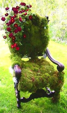 Great idea for that old chair you were going to throw out ~ just cover it in moss and roses! Should be in a secret garden!