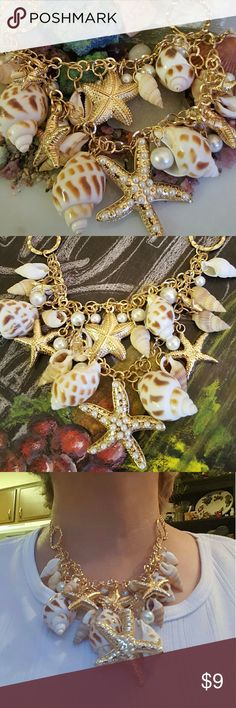 Seashell & Baubles Necklace NEW.  Beautiful seashells, starfish, pearls in a gold plated necklace! Adjustable to wear essay choker or up to a 20 inch necklace! Jewelry Necklaces