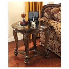 Norcastle collection rich dark brown finish wood end table with glass insert. This includes the end table only with rich dark brown finish. End table measures x x H. Optional coffee table and sofa table available separately. Some assembly required Round End Tables, Coffee And End Tables, Occasional Tables, Side Tables, Table Furniture, Living Room Furniture, Wolf Furniture, Hickory Furniture, Brown Furniture