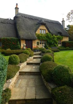 English cottage with thatched roof and boxwood lined path Style Cottage, Cozy Cottage, Cottage Homes, Storybook Homes, Storybook Cottage, Cottages Anglais, English House, English Cottages, Thatched Roof