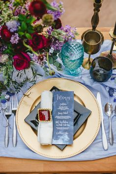 place setting with gem tones - http://ruffledblog.com/bejeweled-wedding-inspiration-with-a-black-and-white-gown
