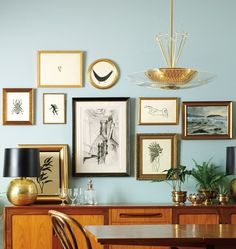 love the frame wall, the retro vibe, the furniture, the light!