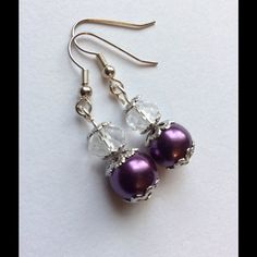 """LAST CHANCE B1G1 SALE  Purple Beaded Earrings These are beautiful. Purple Pearl bead and a clear glass donut, all encased in beautiful silver tone bead caps... Silver tone ear hooks. Approx 1.5"""" long Jewelry Earrings"""