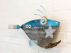 Aloha! I've added another low cost fish to the school! This vibrant little fish makes sure that anyone can have a piece of recycled fine art for their space. This fish was created with love and intended to to be upbeat and energizing, while helping to clean the planet! Made from