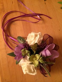 Natural looking silk floral wrist corsage on pearl cuff.