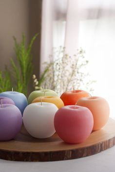 "Each apple candle is hand brushed and comes in 3 x 2.5"" Size. www.vancekitira.com/retail"