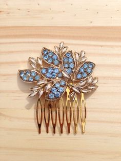 A personal favourite from my Etsy shop https://www.etsy.com/uk/listing/287874705/vintage-blue-hair-comb-1950s-blue