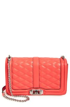 Swooning over this Rebecca Minkoff handbag in a bright shade of coral for a fun and bold style.