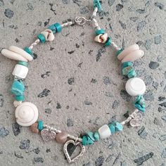 #Repost @eden_azure  ||| Speckled Shells  $35  Anklet |||  One only!! Mixed beads and silver heart charms  #beachanklets#summer#silver#silverhearts #turquoise#turquoisebeads#boho#shells #sand#surf#anklebling#island#islandvibes #islandgirl