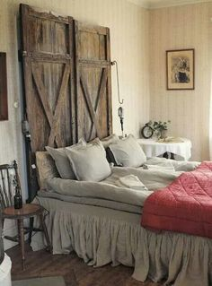 Wooden door headboard hanging shop lights feathered bed antique rustic country