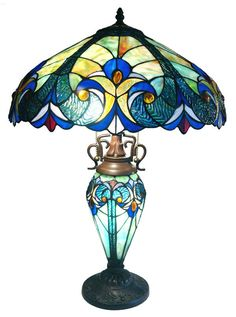 Vintage-style lighting that takes its vibe from the mid-century modern movement. This Victorian Tiffany Style Multi-Colored Glass Table Lamp features a fantastically mod decorative frame that floats over any space elegantly with Stained Glass Table Lamps, Stained Glass Light, Tiffany Stained Glass, Tiffany Glass, Fused Glass, Victorian Table Lamps, Antique Lamps, Vintage Lamps, Victorian Art