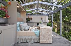 This outdoor Murphy bed is covered in shabby chic bedding.