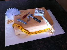 Tools For Aaron This cake was for my good friend's son Aaron. He likes tools, even though he's not allowed to play with them. I...