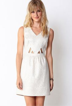 Love 21 - A metallic woven brocade dress featuring a cutout waist. V-neckline. Sleeveless. Expose...