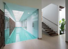 Anyone for an indoor lap pool? The Running Wall Residence by LIJO RENY architects.