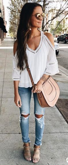 This simple look is what I love. The skinny jeans and white detailed top off the shoulder is so cute. The bag is amazing