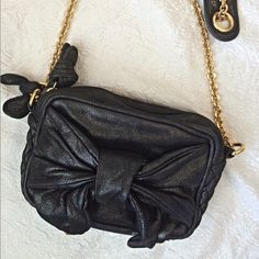 "Leather Juicy Couture Bag This adorable little bag is dressy enough for a wedding with the sparkle in its leather! It's will look fine with your jeans too. Measures 8"" wide by 5"" tall and 3"" thick. Has a large open pocket on inside! Chain has a 21"" drop . Juicy Couture Bags"