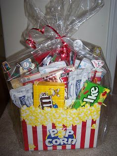 My Delicious Ambiguity: DIY Holiday Gift Baskets - Movie Gift Basket from Crafting in Laymon's Terms. Holiday Gift Baskets, Diy Gift Baskets, Diy Holiday Gifts, Raffle Baskets, Craft Gifts, Cute Gifts, Diy Gifts, Christmas Gifts, Christmas Hamper