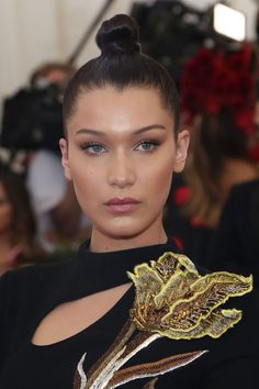 Hadid's top-knot is sleek and refined, keeping the focus on her radiant complexion.