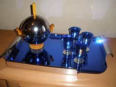 Art Deco Cocktail Set, ca. 1940s, with beautiful and fragile blue mirror and chrome cocktail tray, and ice bucket from Revere with cobalt blue glass insert for ice and bakelite finishings.