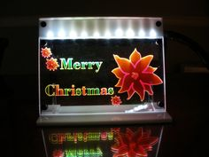 LED lit Poinsettia Merry Christmas decoration by MLSLaserEngraving