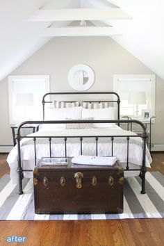 Simple and serene guest room makeover.  Great way to use/show off Grandpa's old military trunk.