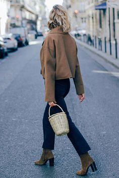 Camel jacket, kick flare jeans, brown sock booties, straw bag. Street style, fall outfits, winter outfits, edgy outfit, trendy outfits, fall trends 2017, casual outfits.