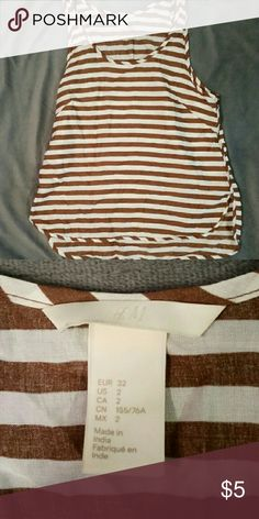 H&M Striped Tank Bronze/brown and white striped tank from H&M only worn twice. Size 2 but it fits like an XS. Appreciate buyers and anyone willing to make an offer, happy shopping!!! H&M Tops Tank Tops