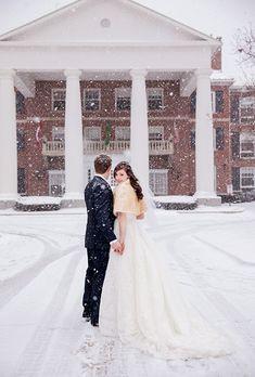 A romantic, snow-covered moment | @geminiphoto | Brides.com